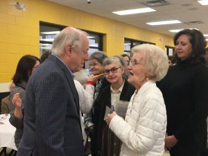 Former Governor and Democratic U.S. Senate Candidate Phil Bredesen speaks with retired teacher Sherry Bush at Saturday's DeKalb County Democratic Party Mass Meeting at DCHS
