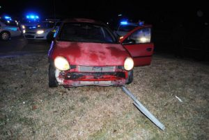 2005 Dodge Neon knocks over stop sign. Occupants flee but were later arrested