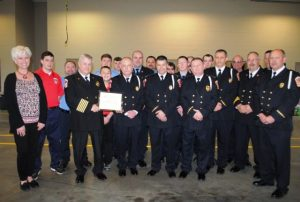 """Chamber Director Suzanne Williams presented a Chamber """"Milestone Award"""" Sunday to the Smithville Volunteer Fire Department for 80 years of service to the community"""