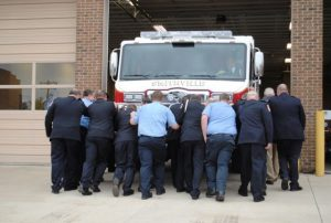 Members of the Smithville Volunteer Fire Department officially placed into service the city's new fire truck during a brief ceremony historically known as a 'push back.'