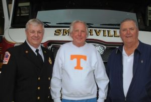 Smithville Fire Chief Charlie Parker with two former city firefighters at Sunday's 80th anniversary observance, Billy Joe Cripps (center), and Freddy Colvert (right).