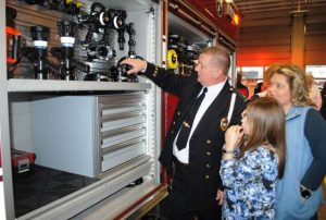 Lieutenant Donnie Cantrell of the Smithville Volunteer Fire Department showing features of the new fire truck to guests at Sunday's Open House