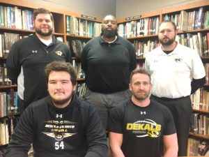 DCHS Football Senior Gage Delape has signed to play at Lindsey Wilson College in Kentucky. Pictured here with Tiger Coach Steve Trapp and assistants Thomas Cagle, Justin Burum, and Tommy Hinch
