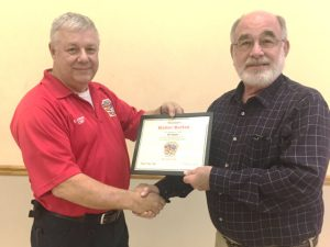 Smithville Fire Chief Charlie Parker presented an award to former Smithville Volunteer Firefighter and local business man Walter Burton, who served for 25 years on the department starting in 1972.