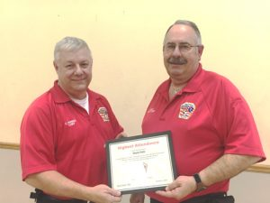 "Smithville Volunteer Firefighter and Deputy Chief Hoyte Hale (right) receives the ""Highest Attendance Award from Chief Charlie Parker"