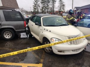 Driverless PT Cruiser runs over Angelia Burke and Knocks down Alecia Burke. It also hits Toyota Camry and Chevy Tahoe
