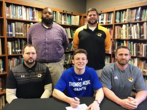 DCHS Football Senior Bradley Miller has signed to play at Thomas More College in Kentucky next season. Pictured: SEATED: Assistant Coach Tommy Hinch, Bradley Miller, Head Coach Steve Trapp; STANDING: Assistant Coaches Justin Burum and Thomas Cagle