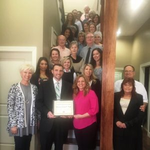 Director Suzanne Williams of the Smithville-DeKalb County Chamber of Commerce and other guests were on hand for the presentation of a Community Improvement Award to Attorney Jeremy Trapp whose law office building was recently renovated.