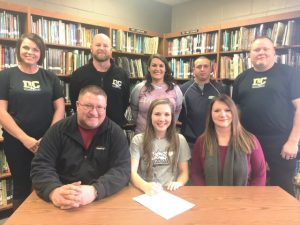 Kristena Bain with family and coaches