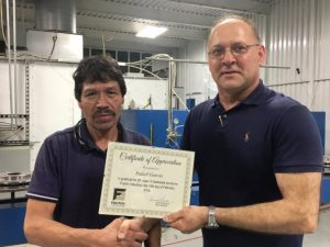 Tracy Foutch of Foutch Industries presented a certificate to Rafael Garcia for 20 years of service, the longest serving employee, during an employee appreciation lunch Thursday