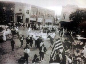 The building can be seen in the background on the public square during a celebration for WWI veterans
