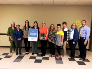 Pictured from left to right: Lisa Cripps, Helen Sefsik, Megan Kinslow, Colleen Wright, Elise Driver, Mandy Lawson, Norene Puckett, Shan Burklow, Kristi Paling, and Sheriff Patrick Ray.
