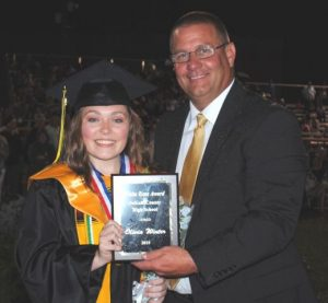 Olivia Winter Receives White Rose Award from DCHS Principal Randy Jennings