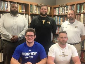 Nick May seated with Tiger Coach Steve Trapp. STANDING: Assistant Coaches Justin Burum, Thomas Cagle, and Tommy Hinch