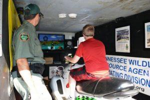 TWRA Officer Joe Fortner shows student how BUI simulator operates