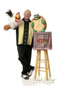 Barry Mitchell with Sam the Tune Turtle and Hyena the Chicken