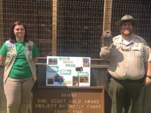 "Girl Scout Neely Evans stands in front of new aviary she built as her Gold Award Project. Also pictured in Brad Halfacre, Park Ranger at Edgar Evins State Park holding ""McKenzie"", a barred Owl that will be housed in the aviary"