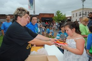 Students getting free school supplies from Dowelltown Baptist Church booth last year at First Day of School Education Celebration