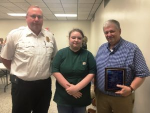 Bobby Hull (right) has received the DeKalb Fire Department's Citizen Hero Award. The presentation was made to Hull by Courtney Nichols (center). Hull is credited for helping save the life of Nichols who was involved in a March traffic accident. Fire Chief Donny Green also pictured