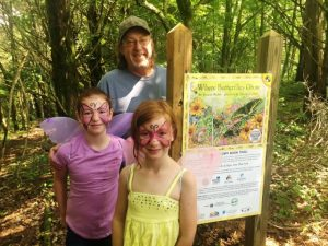 Bruce Tunnicliffe and Skylar and Grace Chausse among the first to walk the Story Book Trail after the ribbon cutting in 2018