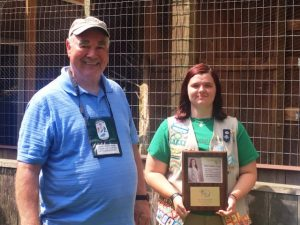 Fount Bertram, President of the Friends of Edgar Evins State Park presents plaque of appreciation to Girl Scout Neely Evans during a brief aviary dedication observance Saturday.