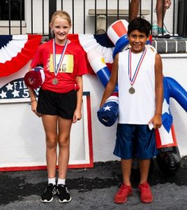 One-Mile Fun Run (age 12 and younger) winners: 11 year old Sylvia Evans of Smithville and 10 year old Gabe Taylor of Readyville. (Photo by Bill Luton Luton's Web ~ Photography ~ Design)