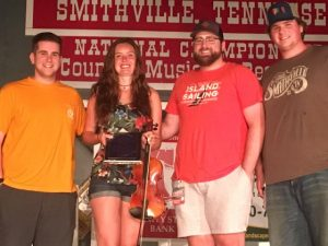 Contest Fiddle for the Neil Dudney Award: First place-Maddie Denton of Murfreesboro. The award was presented to Denton by Dudney's grandsons Ethan, Brandon , and Dylan Shaw.