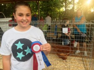 "DeKalb Fair Poultry Show: Laura Magness wins OVERALL ""BEST OF SHOW"" for her Rhode Island Red hen"