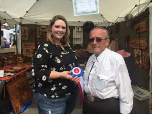 """Jim Everett of Morrison received the Jamboree's """"Best of Show"""" craft award Saturday for his three dimensional wood art. The award was presented by Dana Scott, Director of Crafts"""