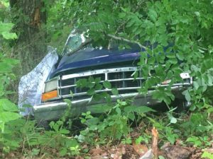 Two people have lost their lives in a pickup truck crash on the Old Mill Hill Road.