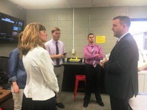 Chris Townson, CEO of DTC Communications (RIGHT) tours Makerspace at DCHS Thursday. Speaking with Dr. Kathy Bryant, Amy Fricks, Cody Burton, and Director of Schools Patrick Cripps