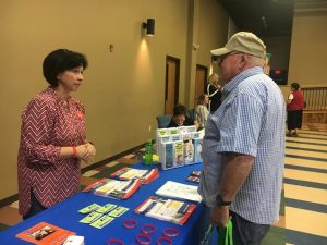 Carl Lee Webb speaks with Suzanne Angel at Health Fair Friday