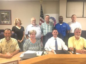 Today's Board of Education: SEATED-Doug Stephens, Jamie Vickers (secretary), Director Patrick Cripps, W.J. (Dub) Evins III. STANDING- Kate Miller, Danny Parkerson, Alan Hayes, Shaun Tubbs, and Jim Beshearse