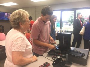 Brenda Cantrell of First Bank observes as DCHS student Richard Brown examines how to repair or make use of parts from a coffee pot for other purposes in the new Makerspace located in the DCHS Media Center/Library.