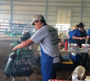 Creston Bain checks on his 1st place lamb chops