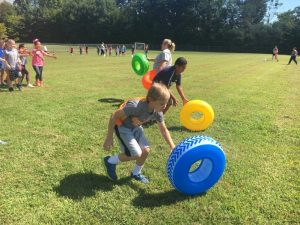Fourth graders running obstacle course during fun run at Northside Elementary School