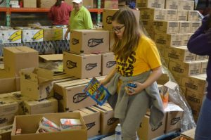 Jr. Beta Chloe Dies helps with food distribution at Joseph's Storehouse in Lebanon.