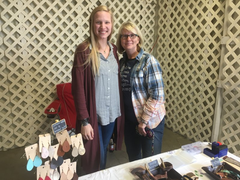 Chelsea Breece (left) of Chelsea's Leather Makes with Melissa Ferrell at the Paislee's Foundation Craft and Home Show Saturday