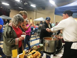 "Jason Evans serving up chili from his booth ""Just Good Chili"" from The Inn at Evins Mill. during 2018 Habitat Chili Cook-Off"
