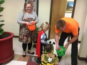 Trustee Sean Driver and Bridgette Rogers greet kids trick or treating during Halloween at the County Complex last year