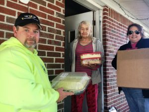 Dustin and Kristie Johnson of the DeKalb County Emergency Services Association delivering Thanksgiving Day meals last year