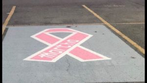 DeKalb Middle School has designated a special parking spot in a show of support for Guidance Counselor Martha Melching, who is seven months pregnant and recently diagnosed with breast cancer.