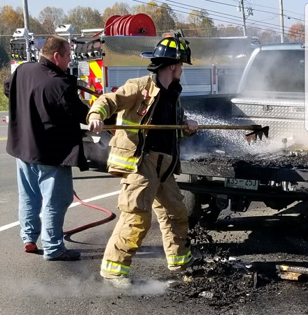 Firewood Rekindles in Back of Pickup Truck (Jim Beshearse Photo)