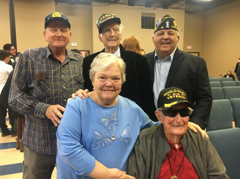 Richard Buford, Vice Commander of the American Legion Department of Tennessee and District Membership Chairman (standing far right) was guest speaker at Friday's Veterans tribute program. Pictured with Judy Redmon and WW II veteran Edsel Frazier (seated) and Vietnam veteran Ronnie Redmon and WW II veteran Edward Frazier