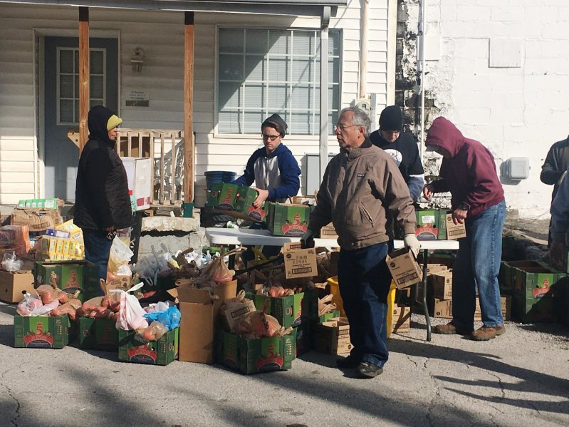 Volunteers preparing food boxes for mobile food pantry