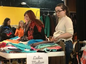 Students making their selections of clothes during Tiger Boutique