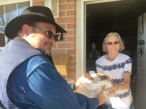 Jeff Roberts delivered Thanksgiving meal last year to Ruth Reeder on behalf of the DeKalb Emergency Services Association