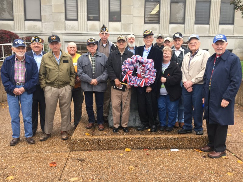 Veterans place wreath at memorial monument following tribute program Friday morning