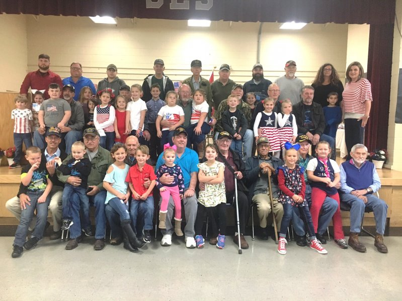 Smithville Elementary students with members of their families (veterans) following an annual tribute program for local hometown heroes Thursday