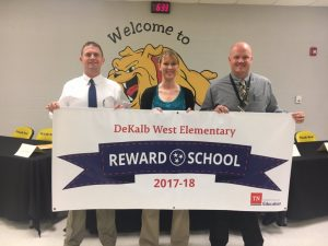 Director of Schools Patrick Cripps joined Principal Sabrina Farler and Assistant Principal Joey Agee in displaying a new banner proudly proclaiming DeKalb West School as a Reward School for 2017-18. The designation was recently announced by the Tennessee Department of Education for the school's academic excellence